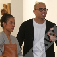 Chris Brown dumps his girlfriend after being photographed with Rihanna